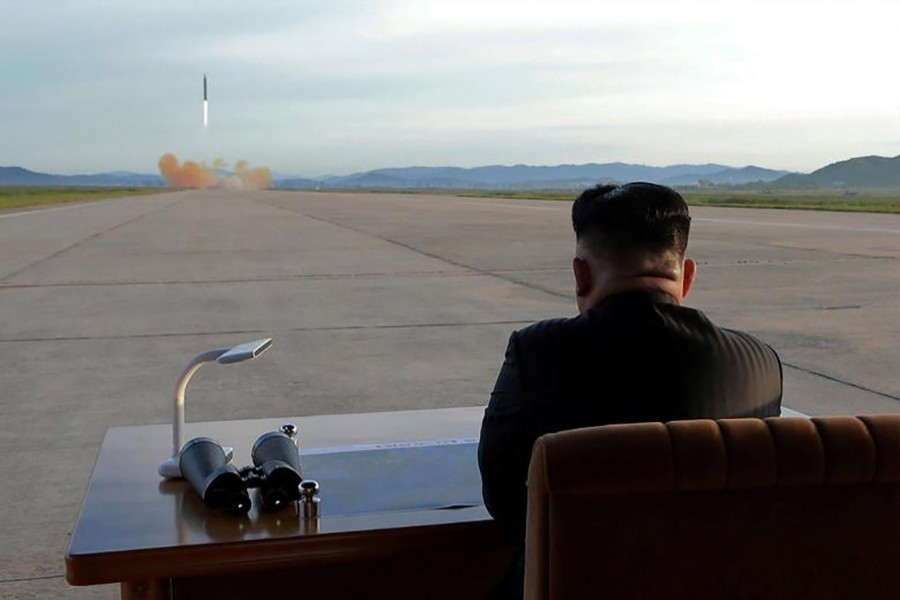 North Korean leader Kim Jong Un watches the launch of a missile in this undated Reuters photo
