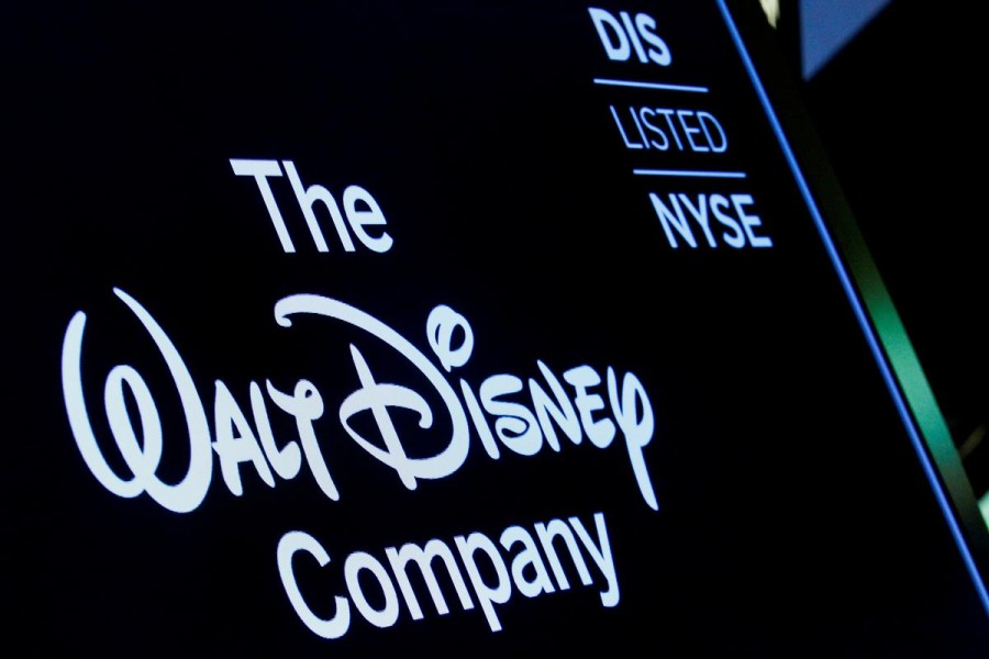 A screen shows the logo and a ticker symbol for the Walt Disney Company on the floor of the New York Stock Exchange (NYSE) in New York, US, December 14, 2017 - REUTERS/Brendan McDermid/File Photo