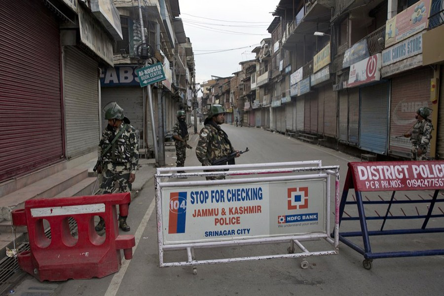 Indian Paramilitary soldiers stand guard during curfew in Srinagar, Indian controlled Kashmir, Wednesday, on August 7, 2019 — AP photo