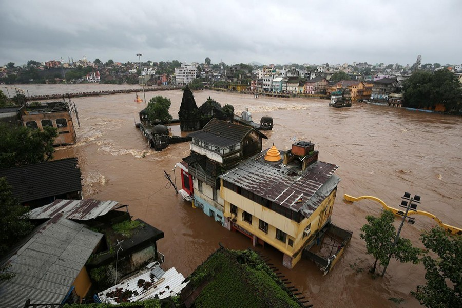 Houses are seen submerged in the waters of overflowing river Godavari after heavy rainfall in Nashik, India on August 5, 2019 — Reuters photo