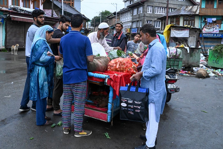 Muslims purchase food and vegetables during a lockdown in Srinagar