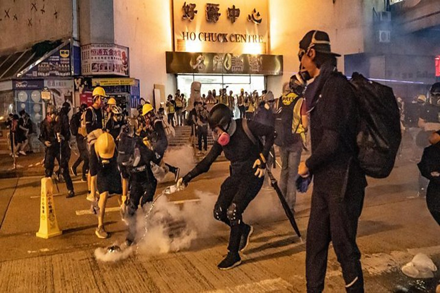 HK protests: Clashes as police fire tear gas into rail station