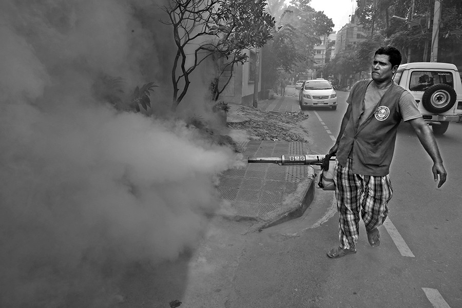 A worker of city corporation sprays anti-mosquito fog in an effort to prevent mosquitoes from breeding at a neighbourhood in Dhaka city — FE/Files