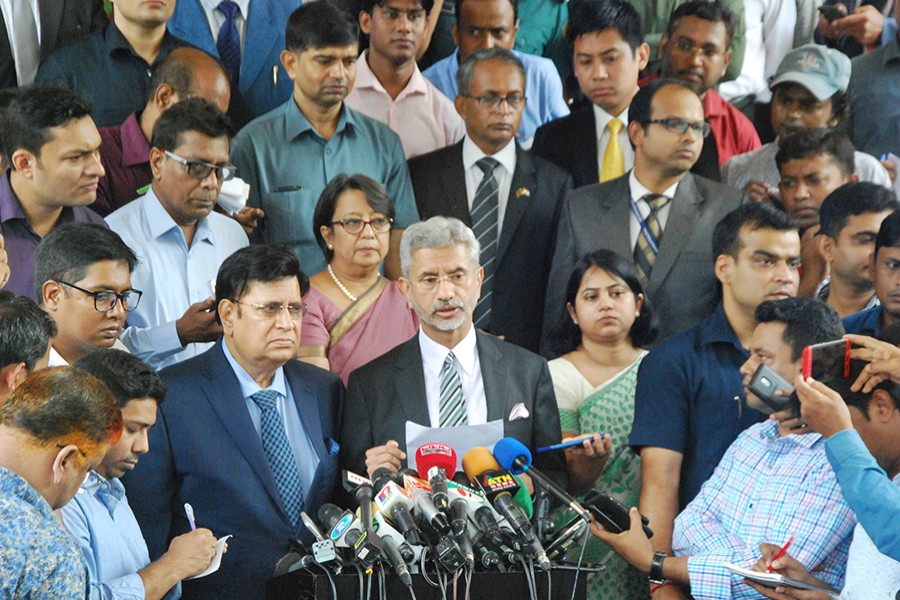 Visiting Indian External Affairs Minister Dr S Jaishankar and his Bangladesh counterpart Dr AK Abdul Momen replying to questions of reporters at a joint media briefing after a bilateral meeting at state guesthouse Jamuna in Dhaka — Focus Bangla photo