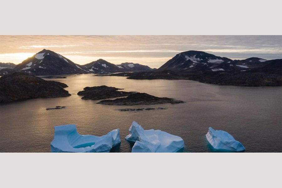 In this August 16, 2019, photo, large Icebergs float away as the sun rises near Kulusuk, Greenland. Scientists are hard at work, trying to understand the alarmingly rapid melting of the ice.  —Photo: AP