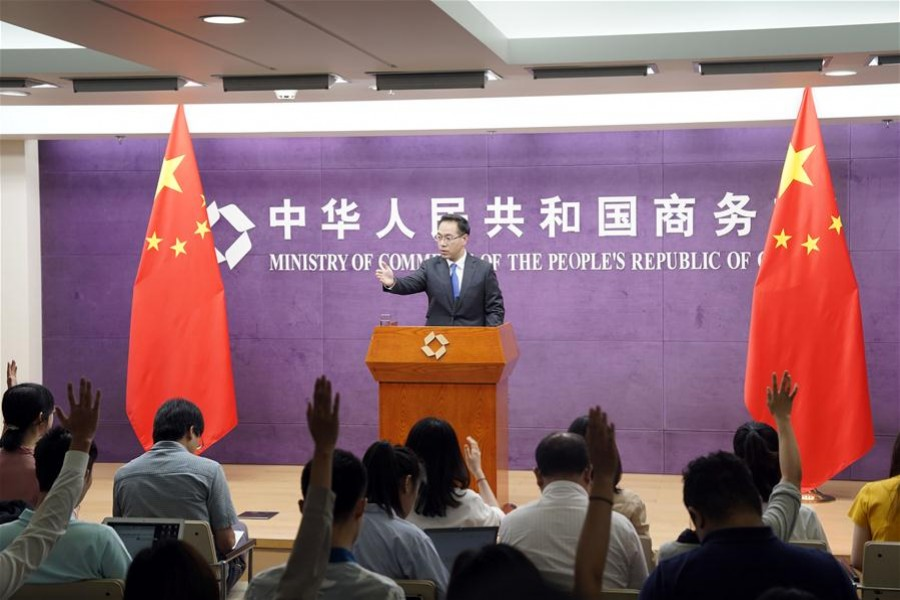 Gao Feng, spokesperson of China's Ministry of Commerce, gestures during the ministry's press conference in Beijing, capital of China, August 22, 2019. Xinhua