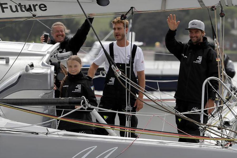 Greta Thunberg and crew's Pierre Casiraghi and Boris Herrmann waving from the Malizia II boat, in Plymouth, Britain, August 14. -Reuters photo