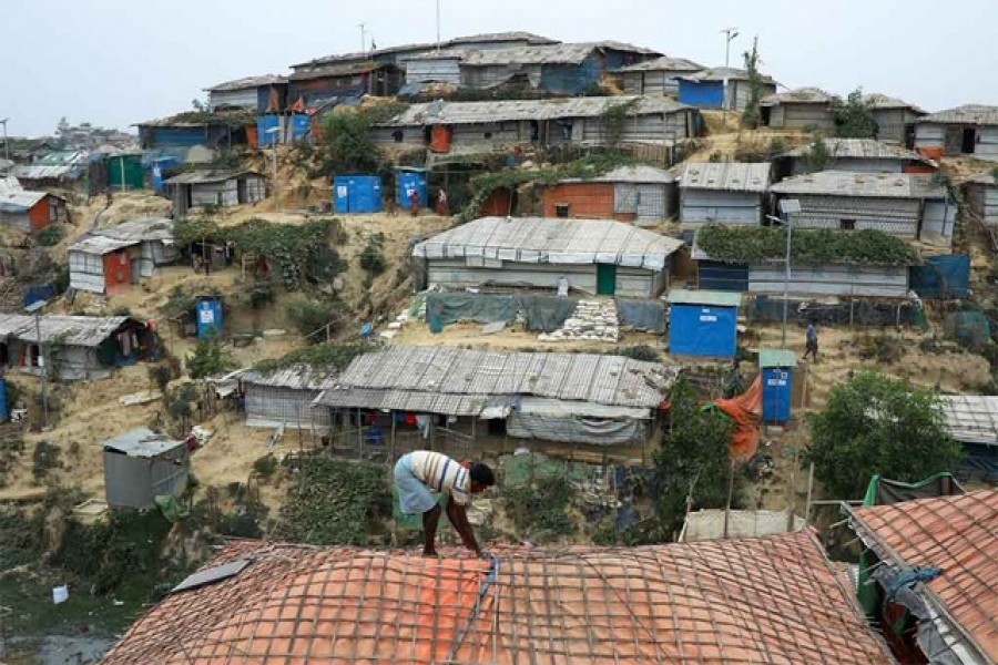 A Rohingya refugee repairs the roof of his shelter at the Balukhali refugee camp in Cox's Bazar, Bangladesh, March 5, 2019. Reuters/Files