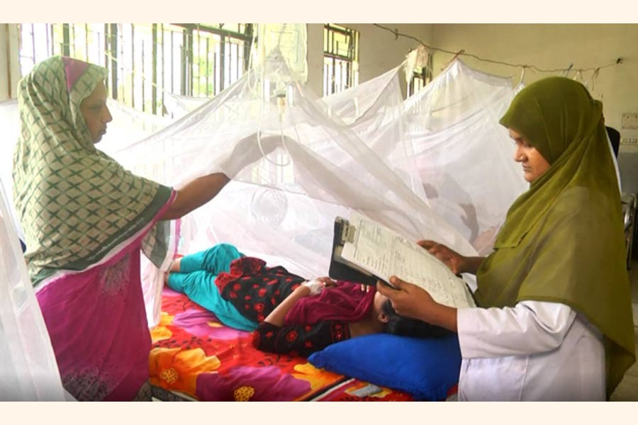 A doctor at Rajshahi Medical College and Hospital checking the reports of a dengue-affected patient on Sunday     — FE Photo
