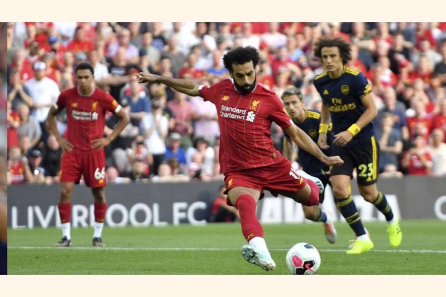 Liverpool's Mohamed Salah scored his side's second goal of the game from the penalty spot during the English Premier League football match against Arsenal at Anfield in England on Saturday 	— AP