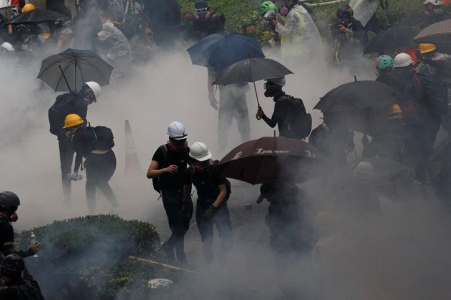 Anti-extradition bill protesters are surrounded by tear gas during clashes with police in Tsuen Wan in Hong Kong, China on August 25, 2019 — Reuters photo