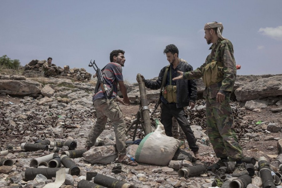 In this Monday, Aug. 5, 2019, file photo, fighters from a militia known as the Security Belt, that is funded and armed by the United Arab Emirates, discuss launching a mortar towards Houthi rebels, in an area called Moreys, on the frontline in Yemen's Dhale province - AP Photo/Nariman El-Mofty, File