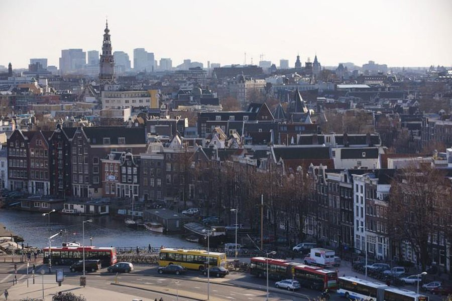 FILE PHOTO - A rootop view of Amsterdam from SkyLounge on the 11th floor of the DoubleTree by Hilton Hotel in Amsterdam April 2, 2013. REUTERS/Michael Kooren