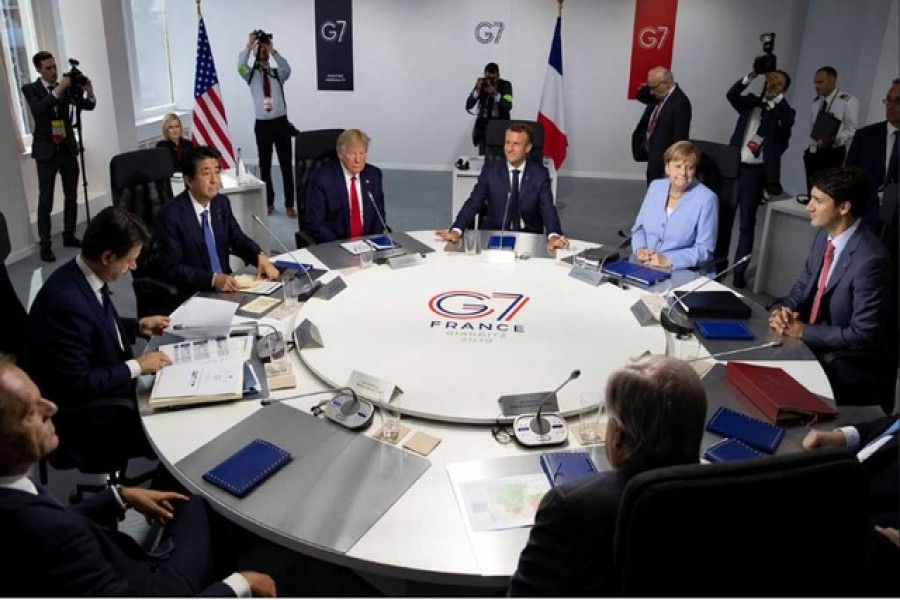 G7 summit: (L-R) EU Council President Donald Tusk, Italian Prime Minister Giuseppe Conte, Japanese Prime Minister Shinzo Abe, US President Donald Trump, French President Emmanuel Macron, German Chancellor Angela Merkel, Canadian Prime Minister Justin Trudeau attend a work session during the G7 summit in Biarritz, France, August 26, 2019. Ian Langsdon/Pool via Reuters