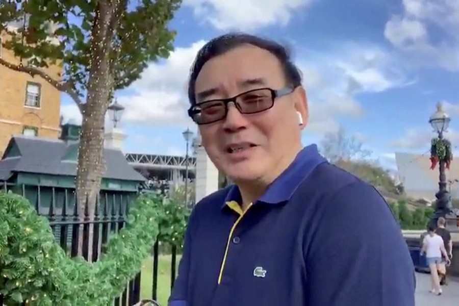 Australian writer Yang Hengjun wishes Happy New Year to his Twitter followers at an unidentified location in this still image from an undated video obtained via social media — Twitter @YANGHENGJUN via REUTERS ATTENTION EDITORS