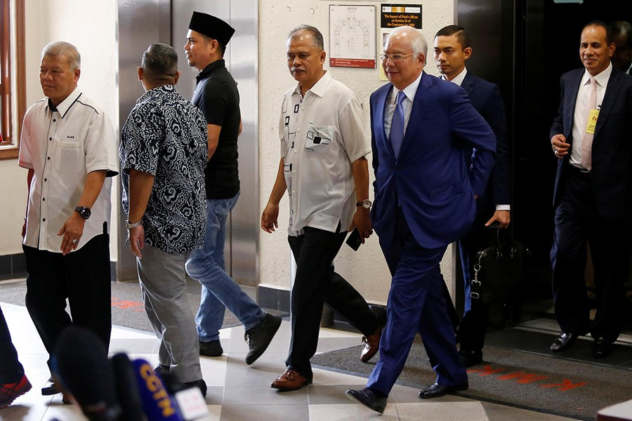 Former Malaysian Prime Minister Najib Razak (with glasses) walks to a courtroom after a break at Kuala Lumpur High Court in Kuala Lumpur, Malaysia on August 28, 2019 — Reuters photo