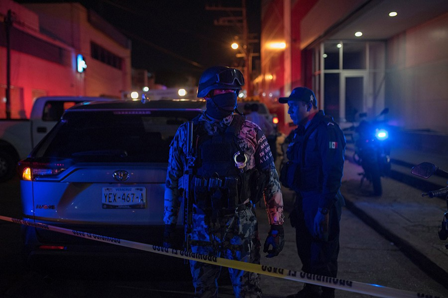Federal forces keep watch at a scene following a deadly fire at a bar in Coatzacoalcos, Mexico on August 28, 2019 — Reuters photo