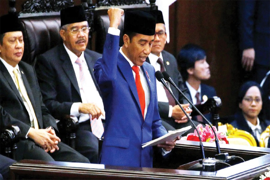 Indonesia President Joko Widodo delivers a speech in parliament in Jakarta on Friday: He formally proposed to parliament on Friday a plan to relocate Indonesia's capital from Jakarta to Kalimantan on the island of Borneo  —Photo: Reuters