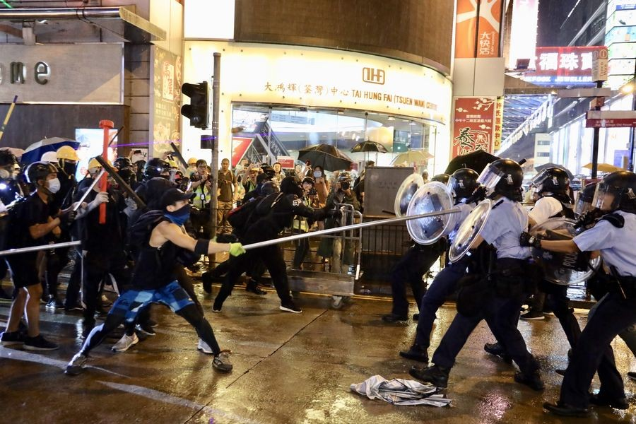 Radical protesters attack police officers in Tsuen Wan, in the western New Territories of south China's Hong Kong, Aug 25, 2019. - Xinhua