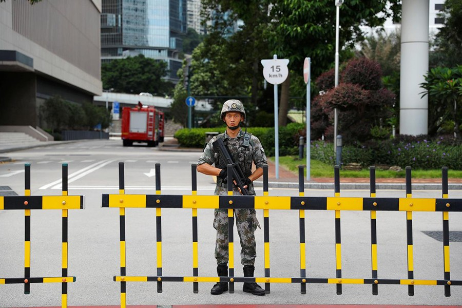 A Chinese People's Liberation Army (PLA) soldier guards the entrance to the PLA Hong Kong Garrison headquarters in the Central Business District in Hong Kong, China on August 29, 2019 — Reuters photo