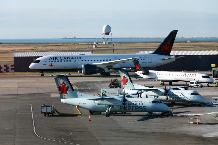 FILE PHOTO: Air Canada airplanes are pictured at Vancouver's international airport in Richmond, British Columbia, Canada, February 5, 2019. REUTERS/Ben Nelms