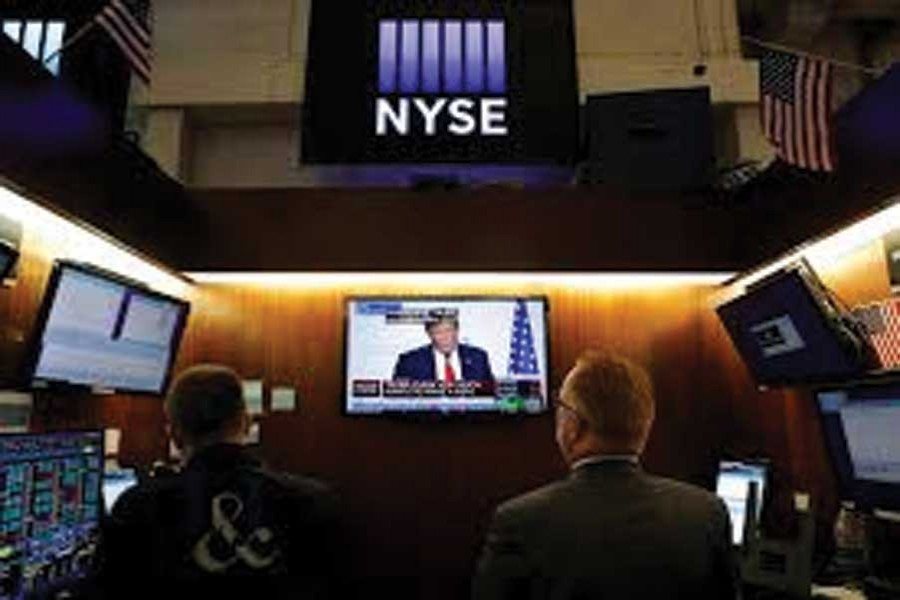 Traders watch monitors displaying a media conference with US President Donald Trump live at the G7 summit on the trading floor at the New York Stock Exchange (NYSE) in New York City, US on August 26, 2019. 	—Photo: Reuters