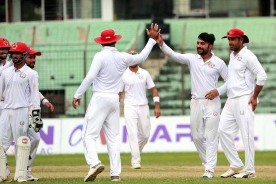 Afghanistan's captain Rashid Khan celebrating after taking a wicket against BCB XI during a practice match in the 2nd and final day at MA Aziz Stadium in Chattogram on Monday— bdnews24.com