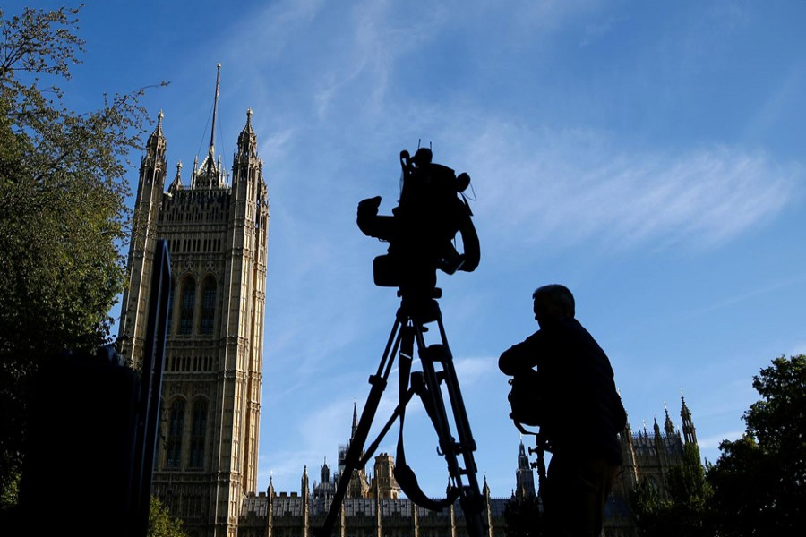 A member of the media sets up a TV camera in front of the Houses of the Parliament in London, Britain, September 2, 2019. Reuters