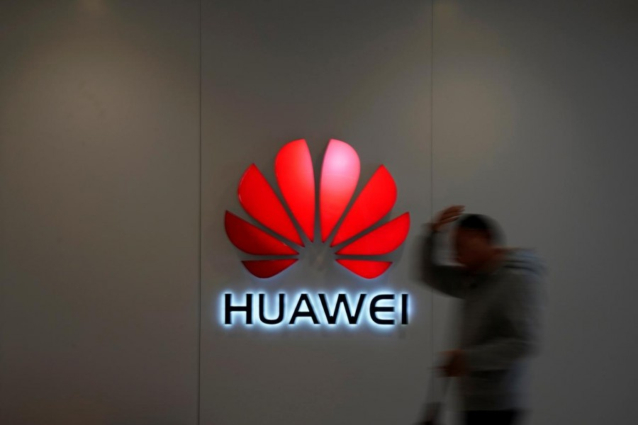 A man walks by a Huawei logo at a shopping mall in Shanghai, China on December 6, 2018 — Reuters/Files