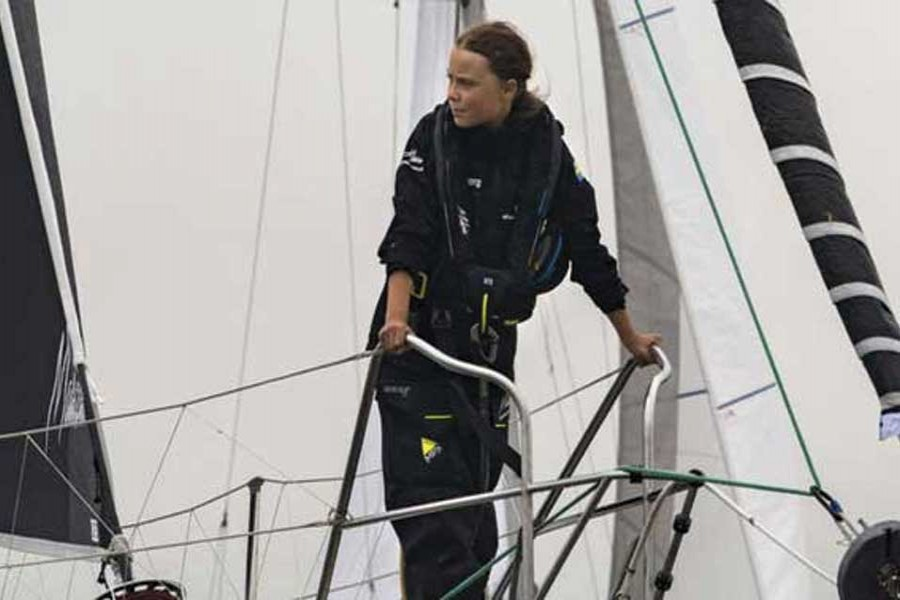 Greta Thunberg, 16-year-old climate activist from Sweden, sails into New York Harbor on August 28, 2019 flanked by a fleet of 17 sailboats representing each of the Sustainable Development Goals on their sails. She embarked on a trans-Atlantic voyage on August 14 from Plymouth, England to New York City on a solar-powered, zero-emission racing boat, the Malizia II, to attend the UN Climate Action Summit in New York September 23, one of six summit meetings scheduled to take place late September. —Photo credit: UN Photo/Mark Garten