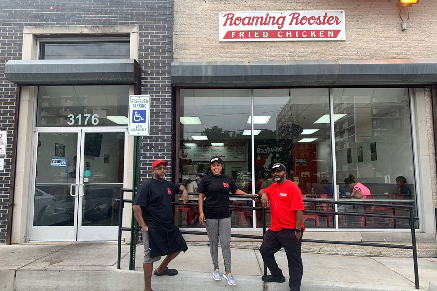 The three owners of Roaming Rooster, a D.C. restaurant whose fried chicken sandwiches exploded in popularity after a viral tweet. From left, Biniyam Habtemariam, his wife, Hareg Mesfin, and his brother Michael Habtemariam - Solomon Photo and Video Production
