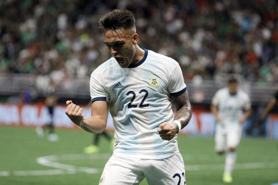 Argentina forward Lautaro Martínez celebrates after scoring a hat-trick against the Mexico at Alamadome — Soobum Im-USA TODAY Sports via REUTERS