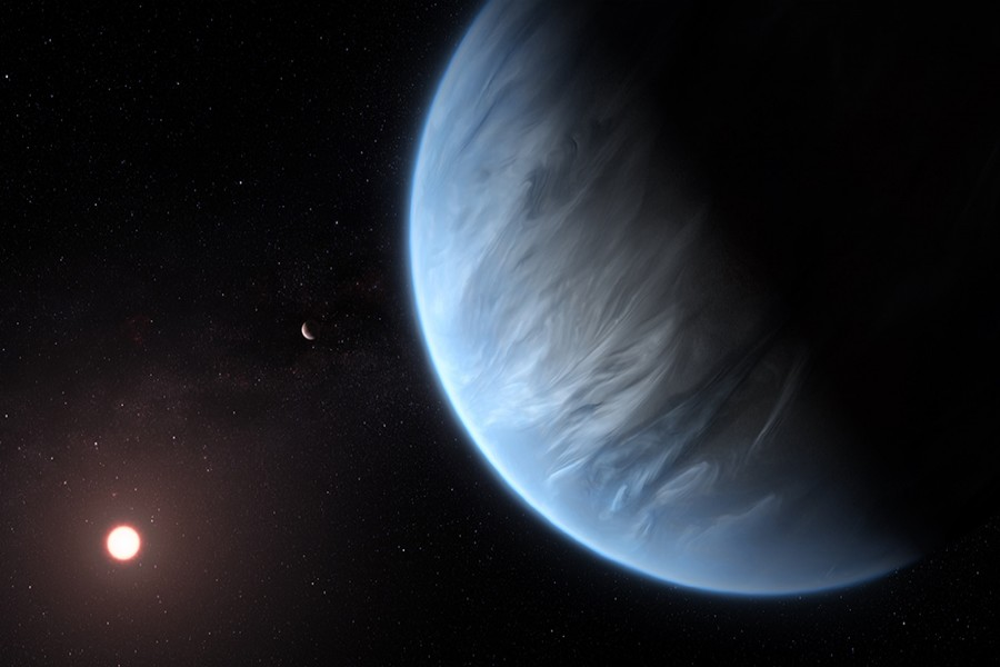 An artist's impression released by NASA on September 11, 2019 shows the planet K2-18b, its host star, and an accompanying planet — NASA Handout via REUTERS
