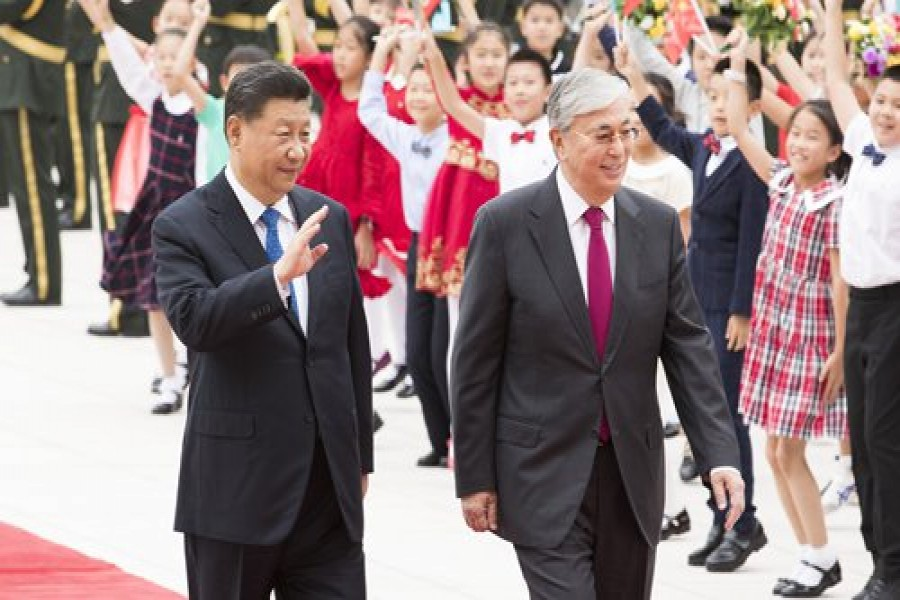Chinese President Xi Jinping (left) and Kazakh President Kassym-Jomart Tokayev walk together at the square of the Great Hall of the People in Beijing on Wednesday. Photo: Xinhua