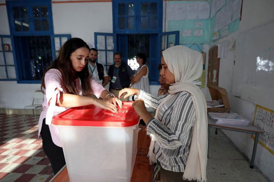 Electoral workers prepare a ballot box inside a polling station during presidential election in Tunis, Tunisia, September 15, 2019. REUTERS/Muhammad Hamed