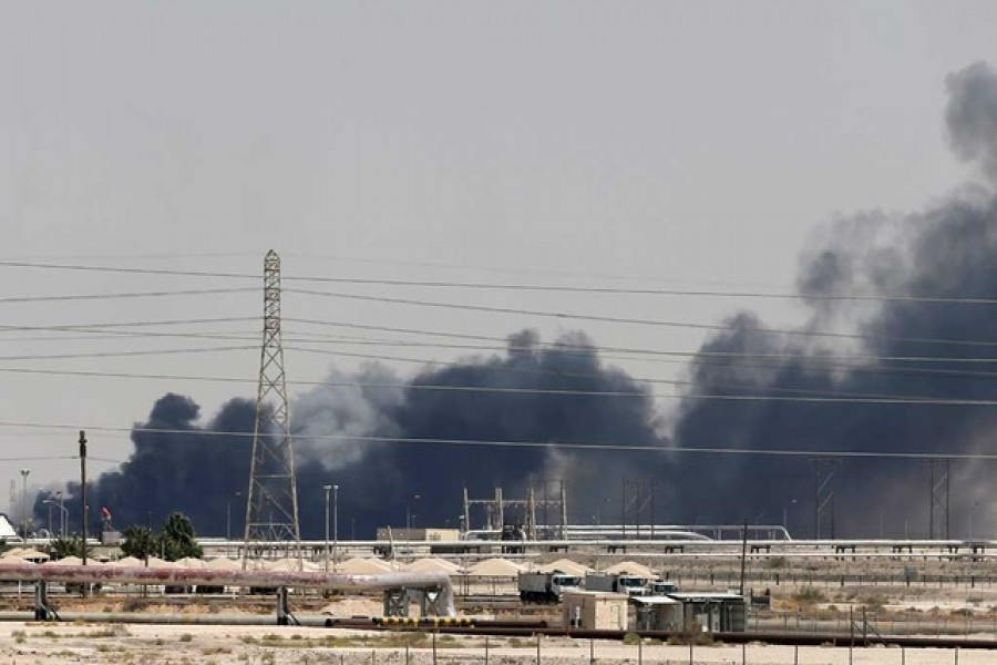 FILE PHOTO: Smoke is seen following a fire at Aramco facility in the eastern city of Abqaiq, Saudi Arabia, Sep 14, 2019. REUTERS