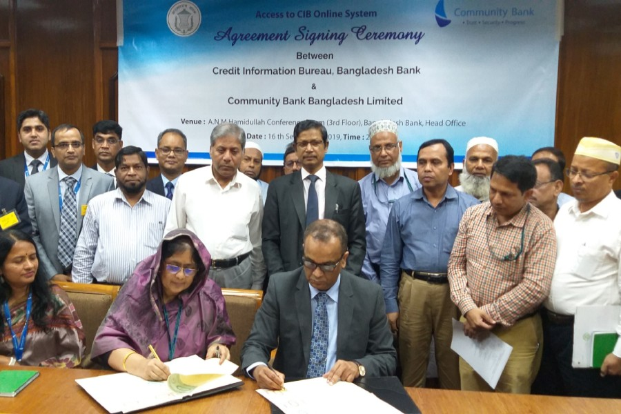 Ms Mansura Parvin, general manager of CIB, Bangladesh Bank (left) and Mr Masihul Huq Chowdhury, managing director & CEO of Community Bank seen signing the agreement on behalf of their respective sides