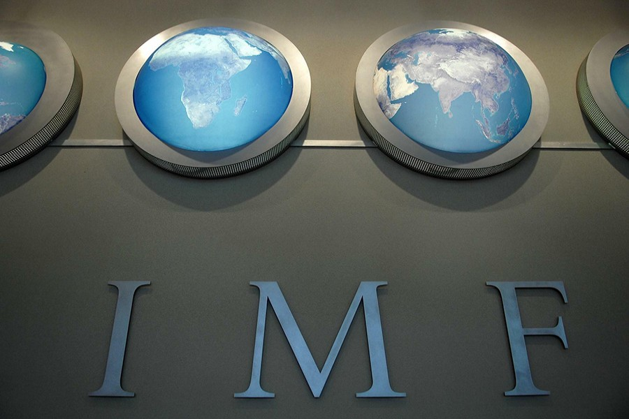 The IMF nameplate is displayed on a wall at the headquarters during the World Bank/International Monetary Fund Spring Meetings in Washington on April 11, 2008 — Reuters/Files