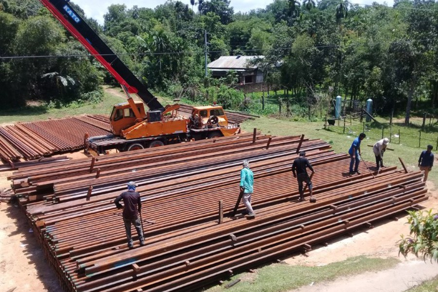 Rail tracks are stockpiled for the reconstruction of the Kulaura-Shahbajpur section of Bangladesh Railway under Indian credit programme 	— FE Photo