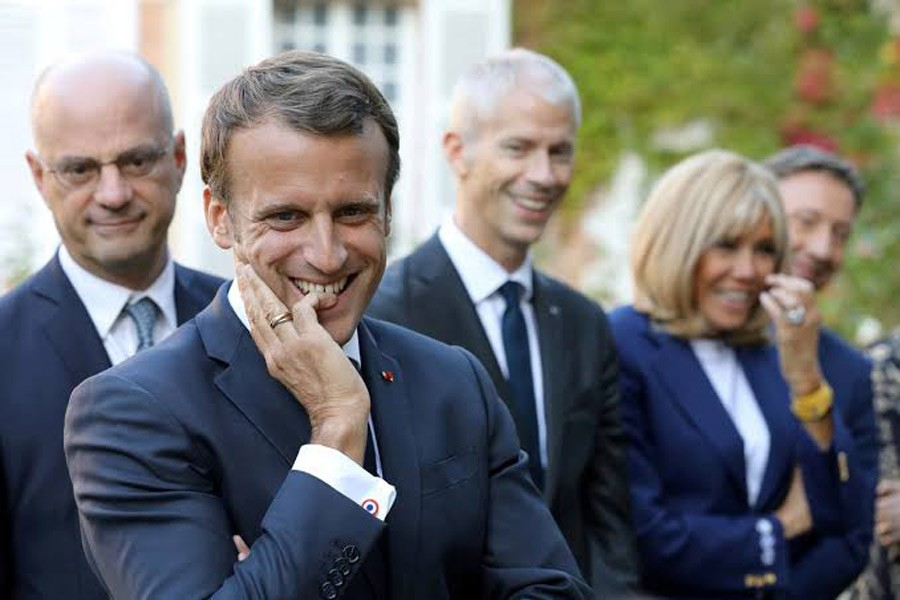 "French President Emmanuel Macron, French Education and Youth Affairs Minister Jean-Michel Blanquer, French Culture Minister Franck Riester and Macron's wife Brigitte Macron, speak with pupils visiting the Chateau de By (""By Castle"") in Thomery, France, September 20, 2019. Reuters"