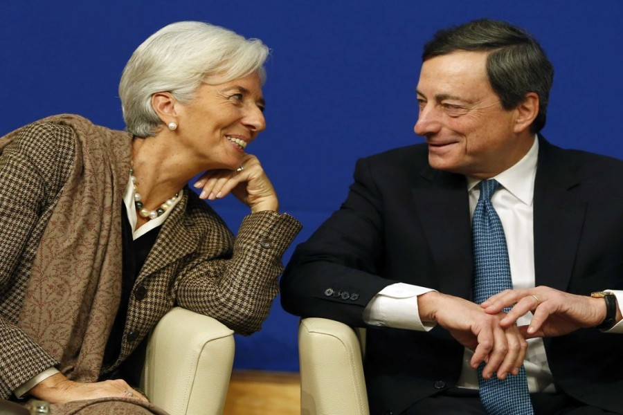 Outgoing president of the European Central Bank Mario Draghi (left) and Christine Lagarde (right) who resigned from the chairmanship of the International Monetary Fund on September 12, following her nomination  as the president of the ECB.  -Reuters  photo
