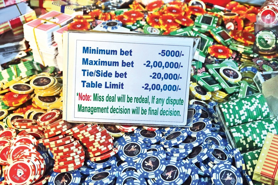 Casino chips and other gambling items seized during a raid by law enforcement personnel on the Victoria Sporting Club at Motijheel in the city on Sunday — FE photo