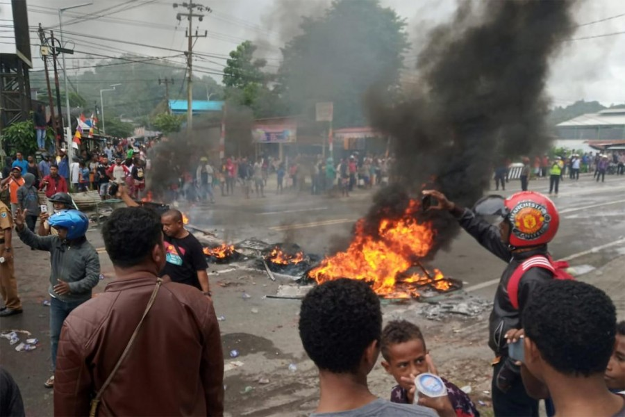 People burn tires during a protest at a road in Manokwari, West Papua, Indonesia, August 19, 2019 in this photo taken by Antara Foto. Antara Foto/Toyiban/via REUTERS