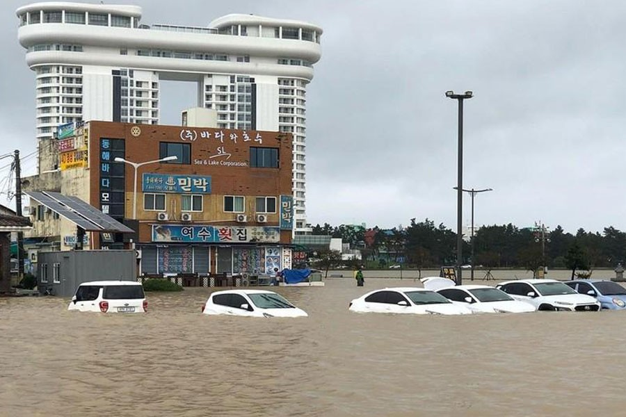 Cars are submerged in floodwater after Typhoon Mitag brought heavy rain and flood to Gangneung, South Korea, October 3, 2019, in this photo obtained from social media. @DIBIDIBOB/via REUTERS