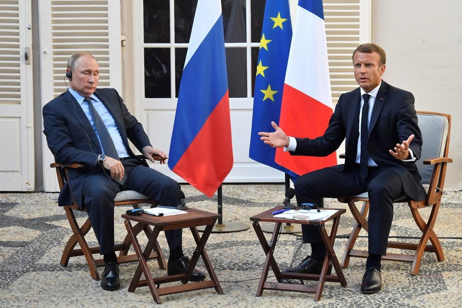 French president Emmanuel Macron meets Russia's president Vladimir Putin, at his summer retreat of the Bregancon fortress on the Mediterranean coast, near the village of Bormes-les-Mimosas, southern France, on August 19, 2019. Reuters/Files