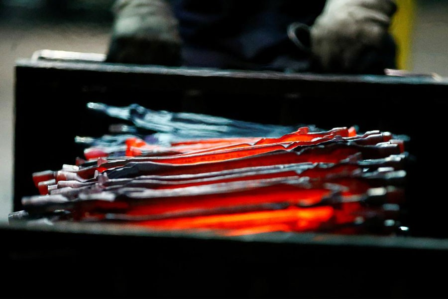 FILE PHOTO - Unfinished pliers still glow after being hot-formed by a hammer at the factory of Knipex, in Wuppertal, western Germany, October 25, 2016. REUTERS/Wolfgang Rattay