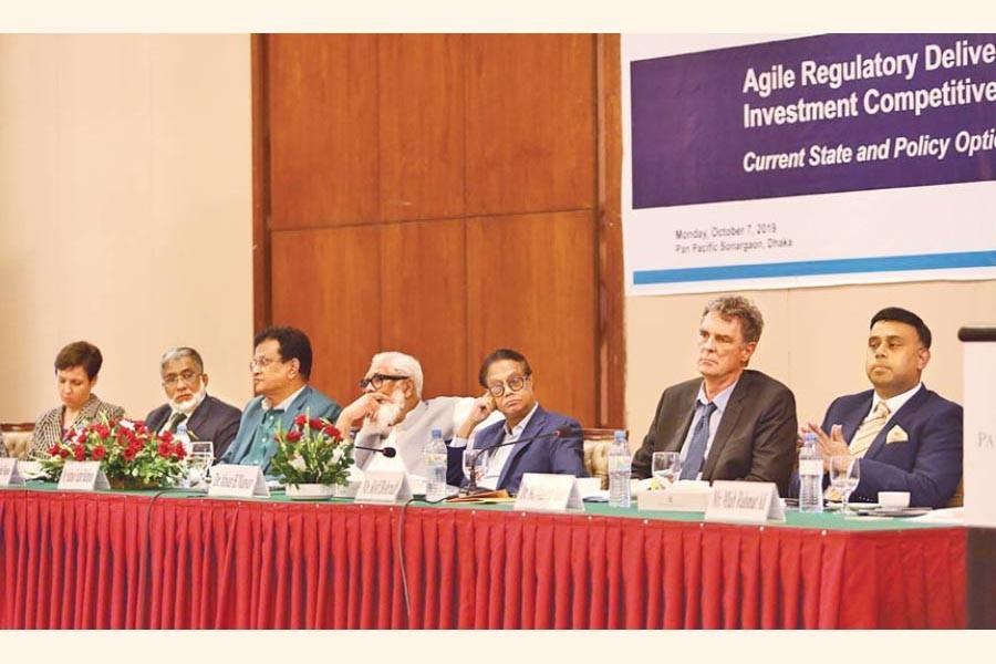 Prime Minister's Adviser on Private Industry and Investment Salman F Rahman (4th from L) seen at the launching of a diagnostic report titled 'Agile Regulatory Delivery for Improved Imvestment Competitiveness: Current State and Policy Options' orgnised at a city hotel on Monday by Policy Research Institute of Bangladesh (PRI), International Finance Corporation (IFC), World Bank Group