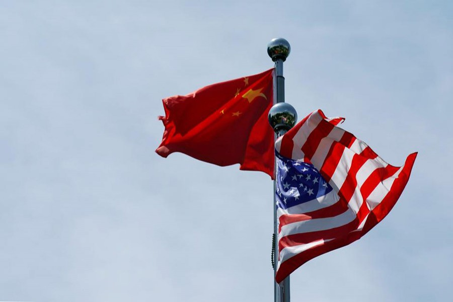 Chinese and US flags flutter near The Bund, before US trade delegation meet their Chinese counterparts for talks in Shanghai, China July 30, 2019. Reuters/Files