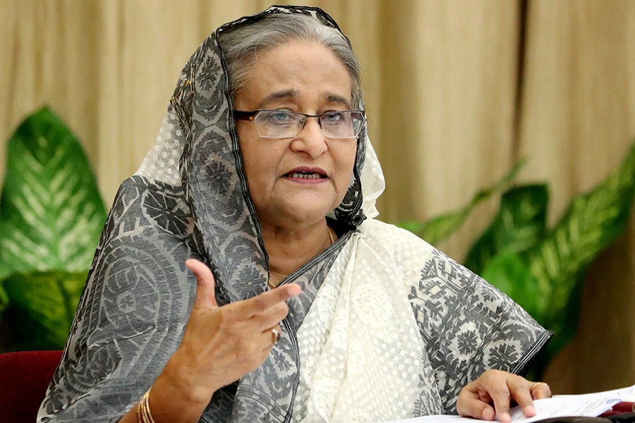 Prime Minister Sheikh Hasina addressing a press conference at her official residence Ganabhaban in Dhaka on Wednesday about the outcome of her recent official visits to New York and New Delhi — Focus Bangla photo