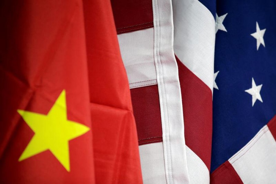 Flags of US and China are displayed at American International Chamber of Commerce (AICC)'s booth during China International Fair for Trade in Services in Beijing, China, May 28, 2019. Reuters/Files